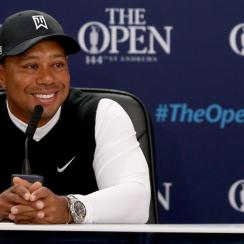 Tiger Woods smiles during a press conference ahead of the 144th Open Championship at the Old Course on July 14, 2015, in St Andrews, Scotland.