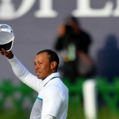 Tiger Woods waves to the fans on the 18th green after missing the cut at the British Open.