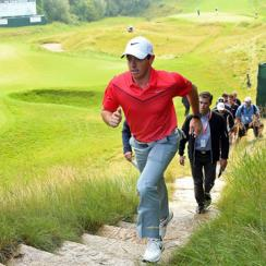 Rory McIlroy of Northern Ireland walks up a set of stairs after a practice round prior to the 2015 PGA Championship at Whistling Straits on August 10, 2015 in Sheboygan, Wisconsin.