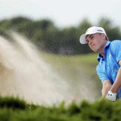 Jordan Spieth hits out of a bunker on the 15th hole during the first round of the PGA Championship golf tournament Thursday, Aug. 13, 2015, at Whistling Straits in Haven, Wis. (AP Photo/Jae