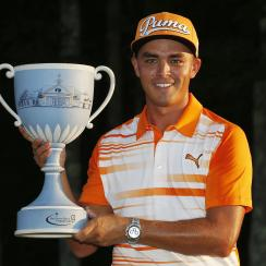 Rickie Fowler holds the trophy after winning the Deutsche Bank Championship golf tournament in Norton, Mass., Monday, Sept. 7, 2015. (AP Photo/Michael