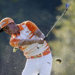 Rickie Fowler hits from the rough on the 13th hole during the final round of the Deutsche Bank Championship golf tournament in Norton, Mass., Monday, Sept. 7, 2015. (AP Photo/Michael