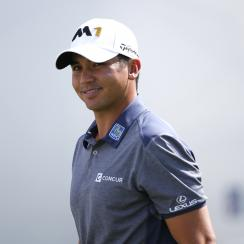 Jason Day, of Australia, smiles as he heads to the first hole during the final round of the BMW Championship golf tournament at Conway Farms Golf Club, Sunday, Sept. 20, 2015, in Lake Forest, Ill. (AP Photo/Charles Rex