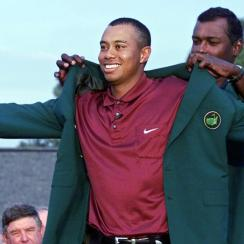 Tiger Woods gets his second green jacket from 2000 Masters Champion Vijay Singh on April 08, 2001 during the final round of the 2001 Masters at the Augusta National Golf Club.