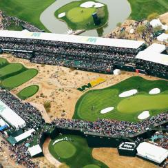 A large group of fans watch the play around the par-three 16th hole during the third round of the Waste Management Phoenix Open at TPC Scottsdale on January 31, 2015 in Scottsdale, Arizona.