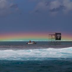 Rainbow on a rainy day at the Billabong Pro Tahiti in Teahupo'o, French Polynesia.