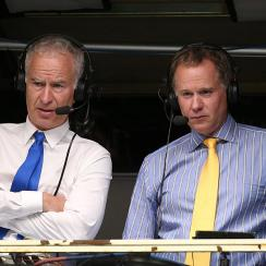 John McEnroe and brother Patrick McEnroe comment matches on Day 5 of the 2014 U.S. Open.