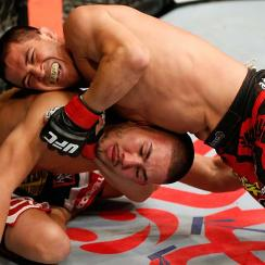 Chris Cariaso attempts to secure a choke against Louis Smolka in their flyweight fight on May 10, 2014, in Cincinnati