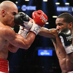 Lamont Peterson lands a right hand to the head of Edgar Santana during their IBF junior welterweight championship fight in Brooklyn, N.Y.