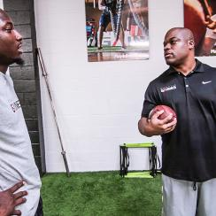 Trainer Travelle Gaines (right) puts Eagles running back LeSean McCoy through a heavy offseason workout.