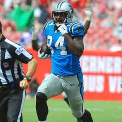 Panthers' Ed Dickson runs for a touchdown after Jonathan Stewart fumbled.