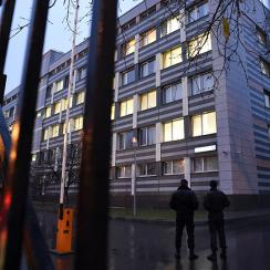 Security guards stand near the building of the 'Federal Scientific Center for Physical Culture and Sports' which houses the Moscow Antidoping Center in Moscow.