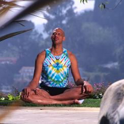 Kareem Abdul-Jabbar practices yoga during a session in 1996.