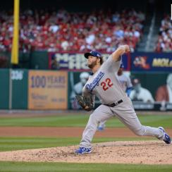 Kershaw pitching against the St. Louis Cardinals at Busch Stadium in October.
