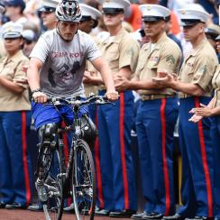 Jones rides past U.S. Marines during Military Opening Day before the Detroit Tigers and San Diego Padres game in April in California.
