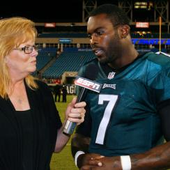 Shelley Smith interviews QB Michael Vick, formerly of the Philadelphia Eagles, after a game in 2013.