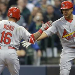 Kolten Wong and Jon Jay celebrate during the Cardinals' win over the Brewers on Saturday.