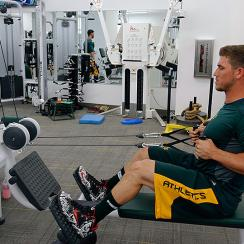 Members of the Oakland Athletics workout in the weight room at Hohokam Stadium in March 2015.
