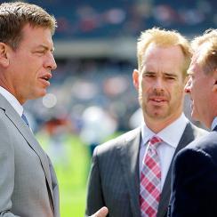 Troy Aikman (left) and Joe Buck (center) speak with NFL commissioner Roger Goodell.