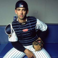 Jorge Posada watches the action from the Yankee Stadium dugout.