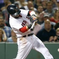 Boston Red Sox's Dustin Pedroia hits a single during the sixth inning of a baseball game against the Kansas City Royals in Boston, Saturday, Aug. 27, 2016. The Red Sox won 8-3. (AP Photo/Michael Dwyer)