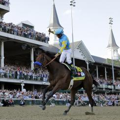 FILE - In this May 2, 2015 file photo, Victor Espinoza rides American Pharoah to victory in the 141st running of the Kentucky Derby horse race at Churchill Downs in Louisville, Ky. Last June, Espinoza was aboard California Chrome during his Triple Crown r