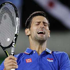 Novak Djokovic, of Serbia, reacts after losing a point to Juan Martin del Potro, of Argentina, at the 2016 Summer Olympics in Rio de Janeiro, Brazil, Sunday, Aug. 7, 2016. (AP Photo/Charles Krupa)