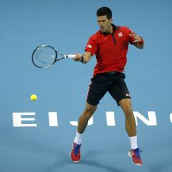Novak Djokovic of Serbia hits a return shot while playing against David Ferrer of Spain during their men's singles semifinal match in the China Open tennis tournament at the National Tennis Stadium in Beijing, Saturday, Oct. 10, 2015. (AP Photo/Mark Schie