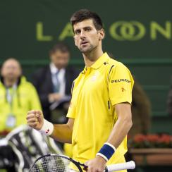 Serbia's Novak Djokovic celebrates winning the Qatar Open 2016 semifinal match against Tomas Berdych of Czech Republic in Doha, Qatar, Friday, Jan. 8, 2016. (AP Photo/Alexandra Panagiotidou)