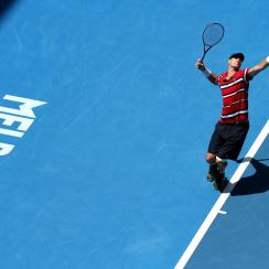John Isner of the United States serves to Feliciano Lopez of Spain during their third round match at the Australian Open tennis championships in Melbourne, Australia, Saturday, Jan. 23, 2016.(AP Photo/Rick Rycroft)