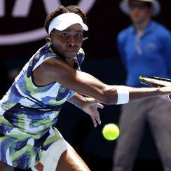 Venus Williams of the United States makes a backhand return to Johanna Konta of Britain during their first round match at the Australian Open tennis championships in Melbourne, Australia, Tuesday, Jan. 19, 2016.(AP Photo/Aaron Favila)