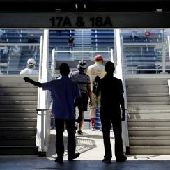 Tennis fans walk into the seating area of the new Grandstand stadium at the USTA Billie Jean King tennis Center, Sunday, Aug. 28, 2016, in New York. The US Open tennis tournament begins on Monday. (AP Photo/Peter Morgan)