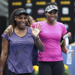 United States' Serena Williams, left, waves to the crowd as she walks onto the court with her sister Venus during an exhibition event ahead of the ASB Classic tennis tournament in Auckland, New Zealand, Sunday, Jan. 1, 2017. (Doug Sherring/New Zealand Her