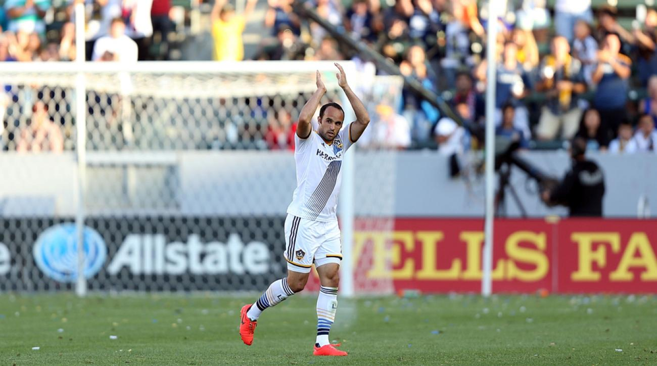Landon Donovan, pictured above after his record-setting performance last weekend, scored his third goal in two games to help the LA Galaxy to a draw with the Chicago Fire on Sunday.