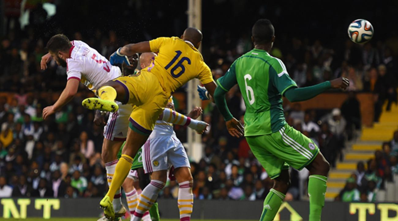 Nigeria goalkeeper Austin Ejide (16) and Scotland's Grant Hanley collide, leading to a disallowed goal in Wednesday's friendly.