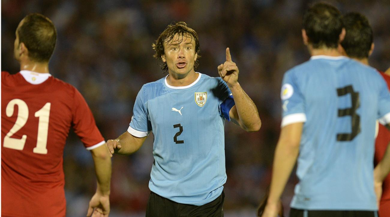 Uruguay captain Diego Lugano's (2) lack of club playing time hasn't hurt his standing as La Celeste's leader on and off the field.