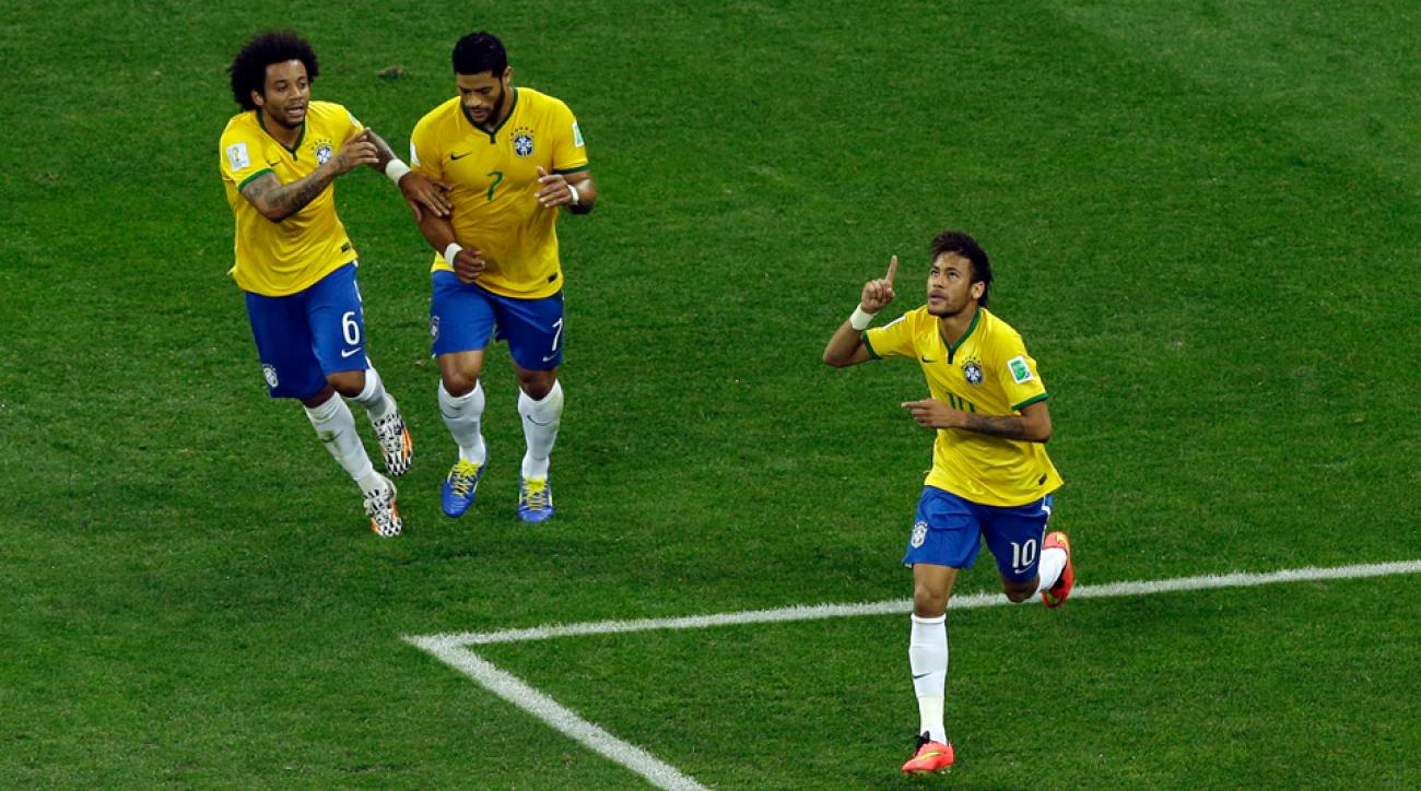 Neymar points to the heavens after scoring a first-half equalizer against Croatia in the opening game of the World Cup.