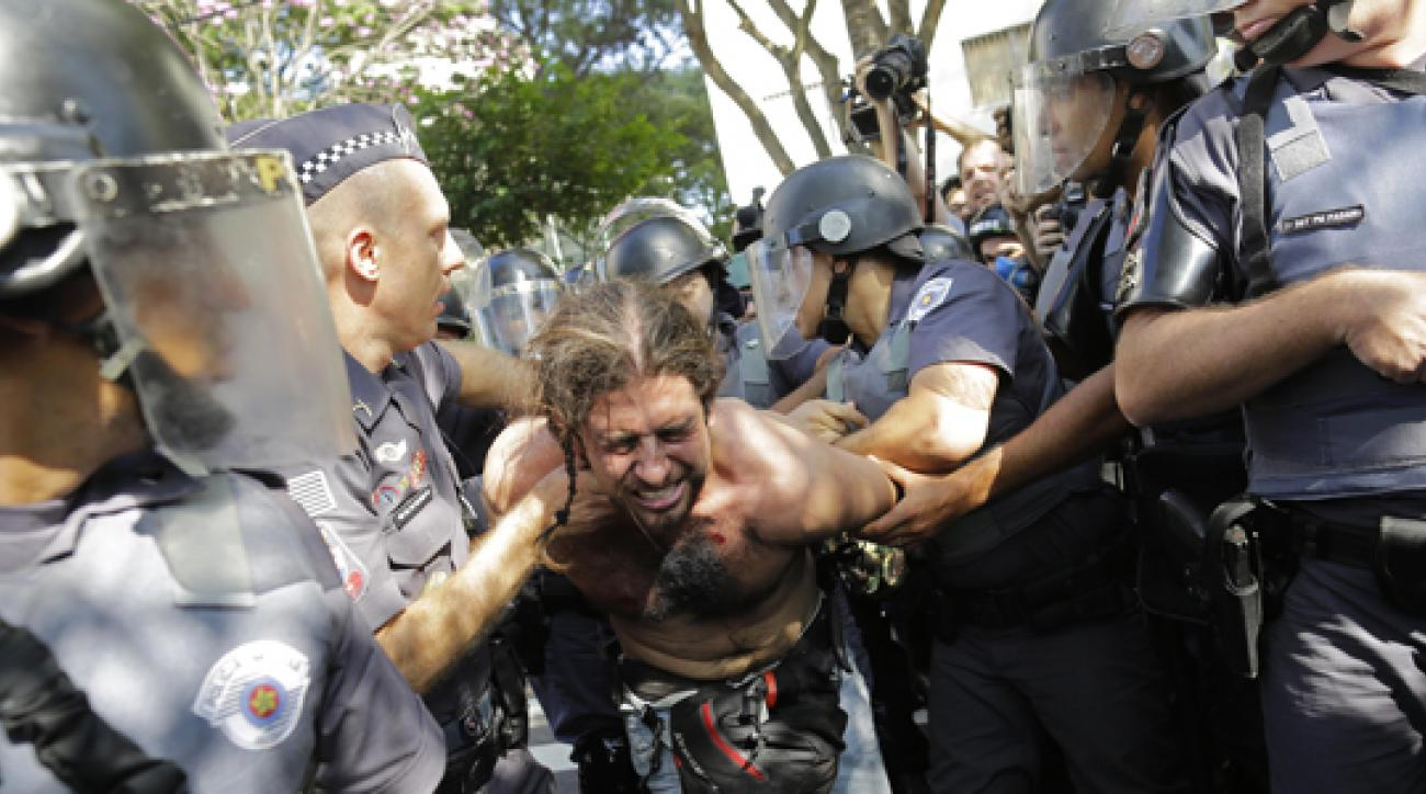 Police detain a man in Sao Paulo, where protesters attempted to block a main highway while demanding for better public services.
