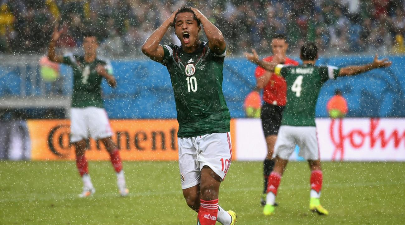 Giovani Dos Santos can't believe the decision that goes against him, negating a would-be goal in Mexico's World Cup opener vs. Cameroon.
