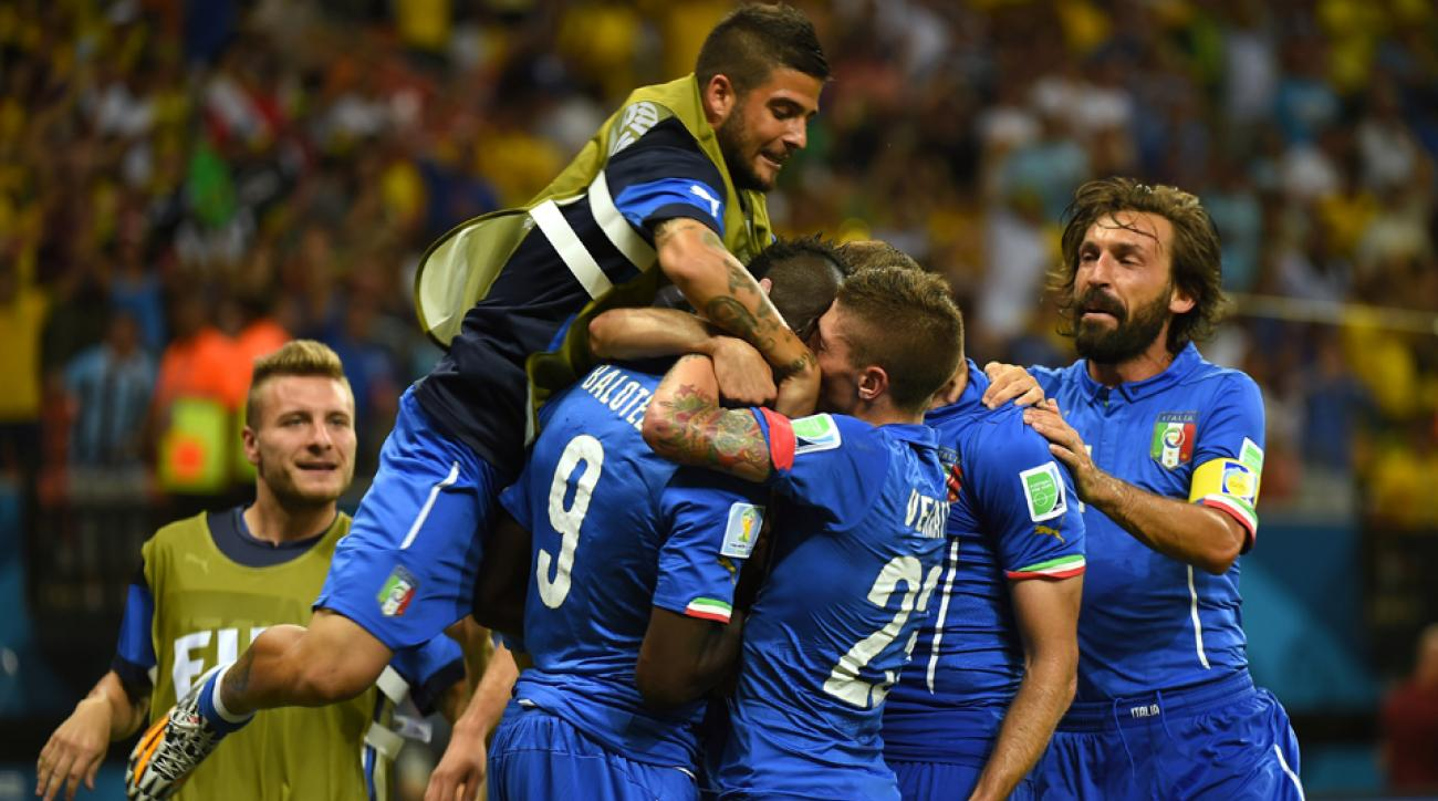 Mario Balotelli (9) is mobbed by teammates after scoring the go-ahead goal for Italy in its 2-1 win over England on Saturday.