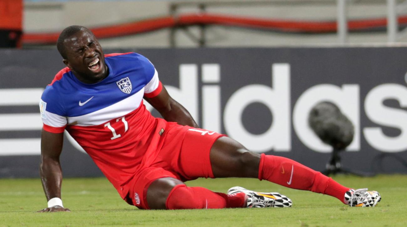 Jozy Altidore shouts in pain while grabbing his injured left hamstring after pulling up lame trying to track a ball down the sideline against Ghana in the USA's World Cup opener.