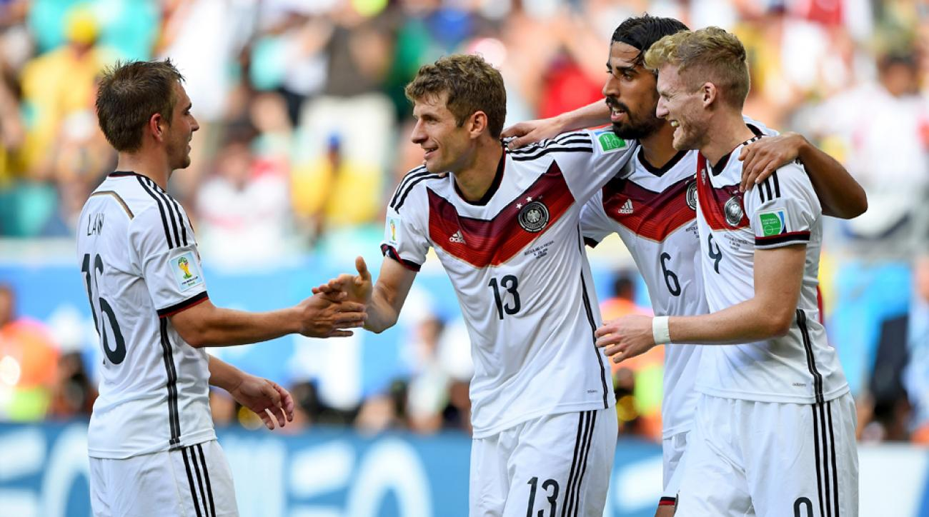 Thomas Muller (13) is congratulated after one of his three goals in Germany's 4-0 win over Portugal in Monday's World Cup Group G opener.