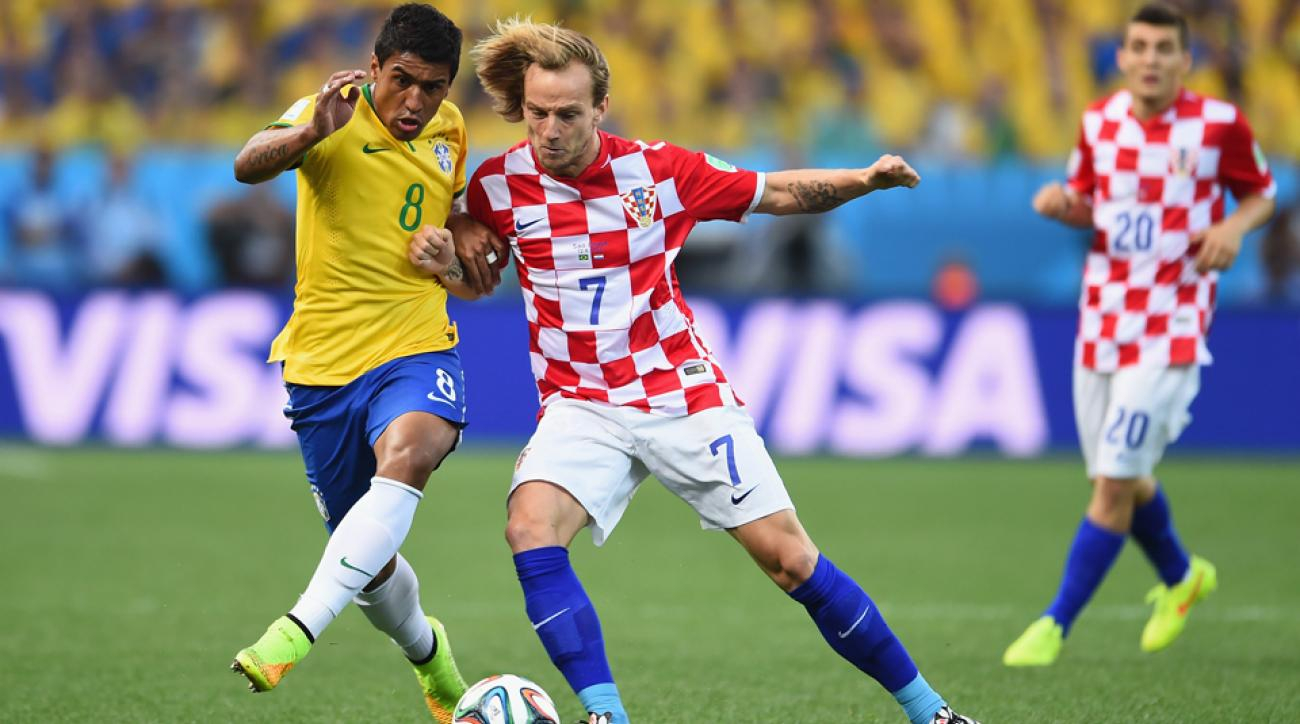 Croatia midfielder Ivan Rakitic (7) has transferred to Barcelona from Sevilla on a five-year deal.