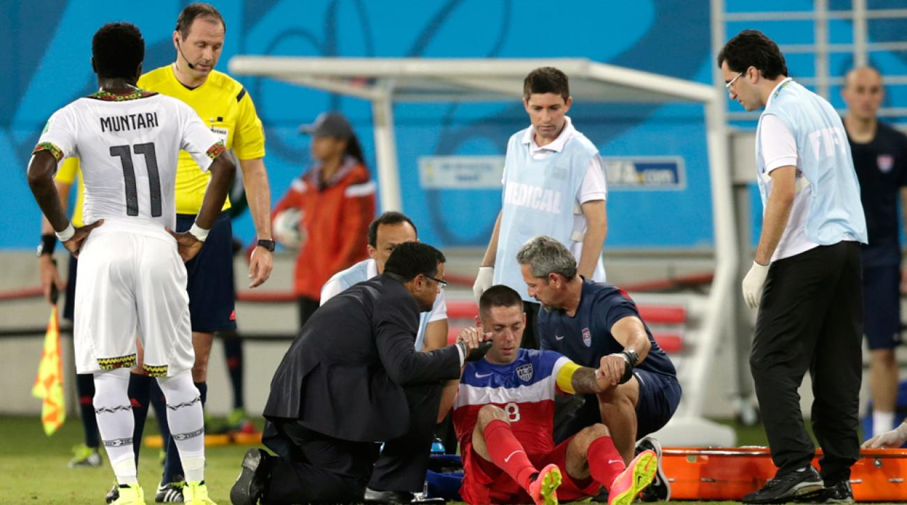 Clint Dempsey is tended to by trainers after taking a boot to the face from Ghana's John Boye. He is expected to play against Portugal despite having a broken nose.