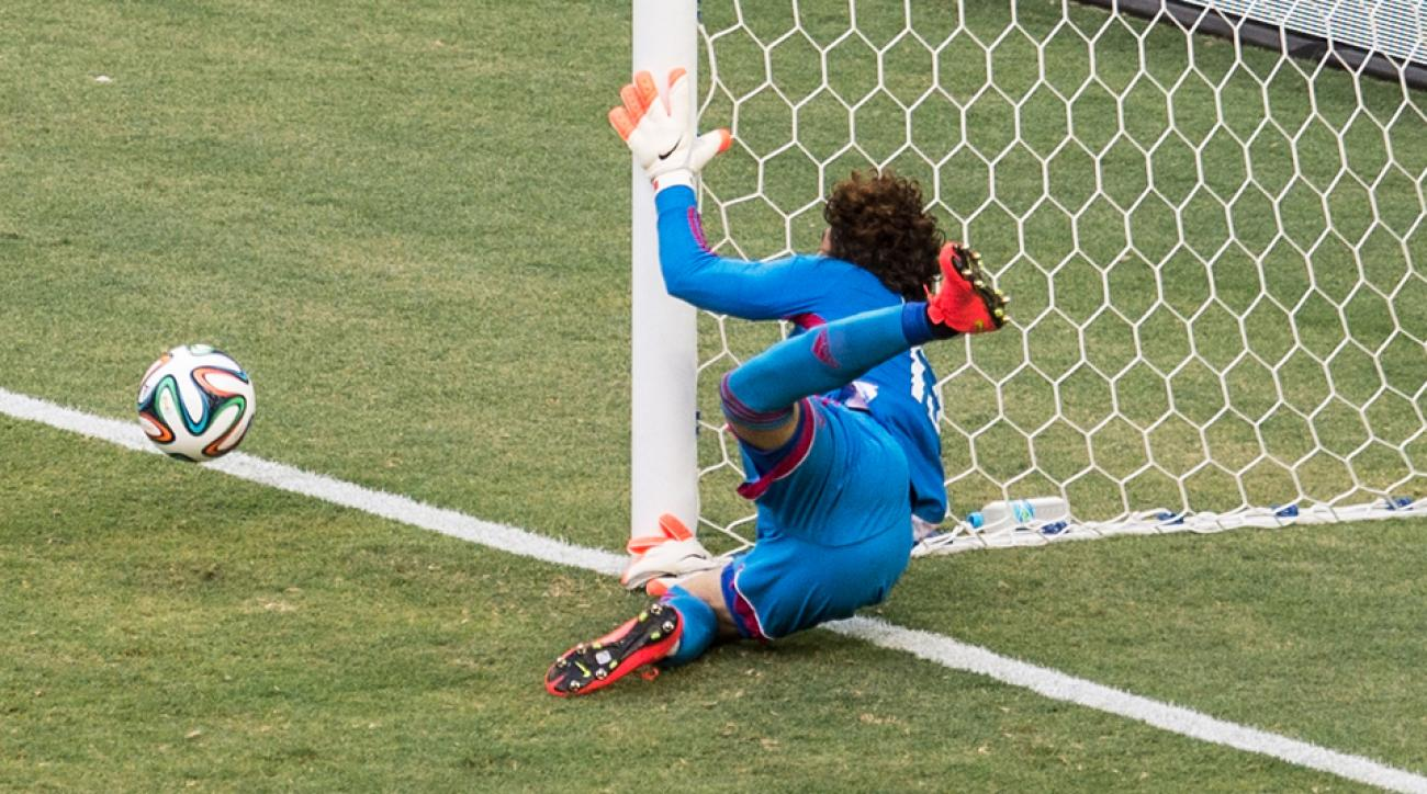 Guillermo Ochoa clamors into the post after making a remarkable save to deny Neymar a goal.