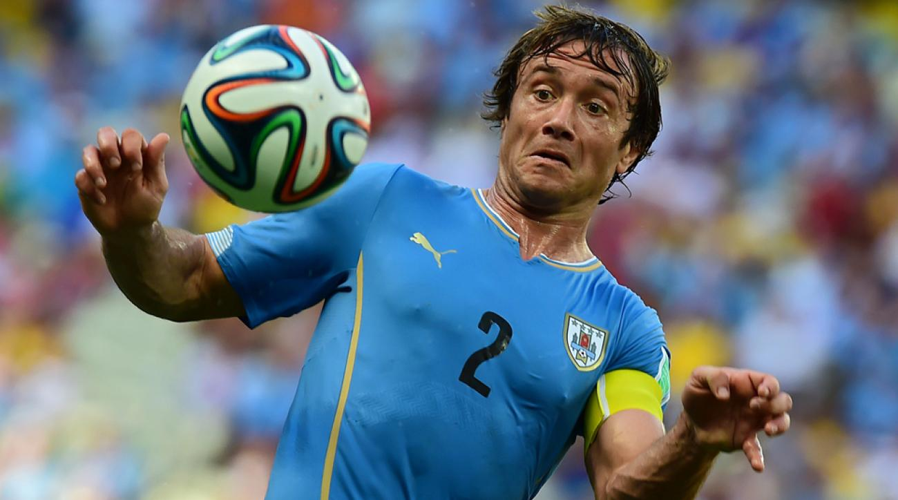 Uruguay captain and center back Diego Lugano has been ruled out for La Celeste's vital match against England with a knee injury.