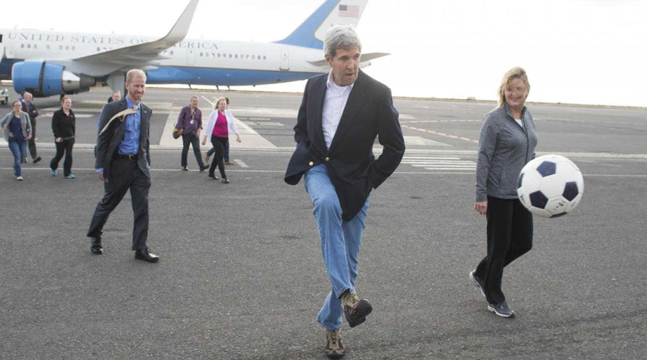 John Kerry kicks a soccer ball around on the tarmac of a Cape Verde airport in May.