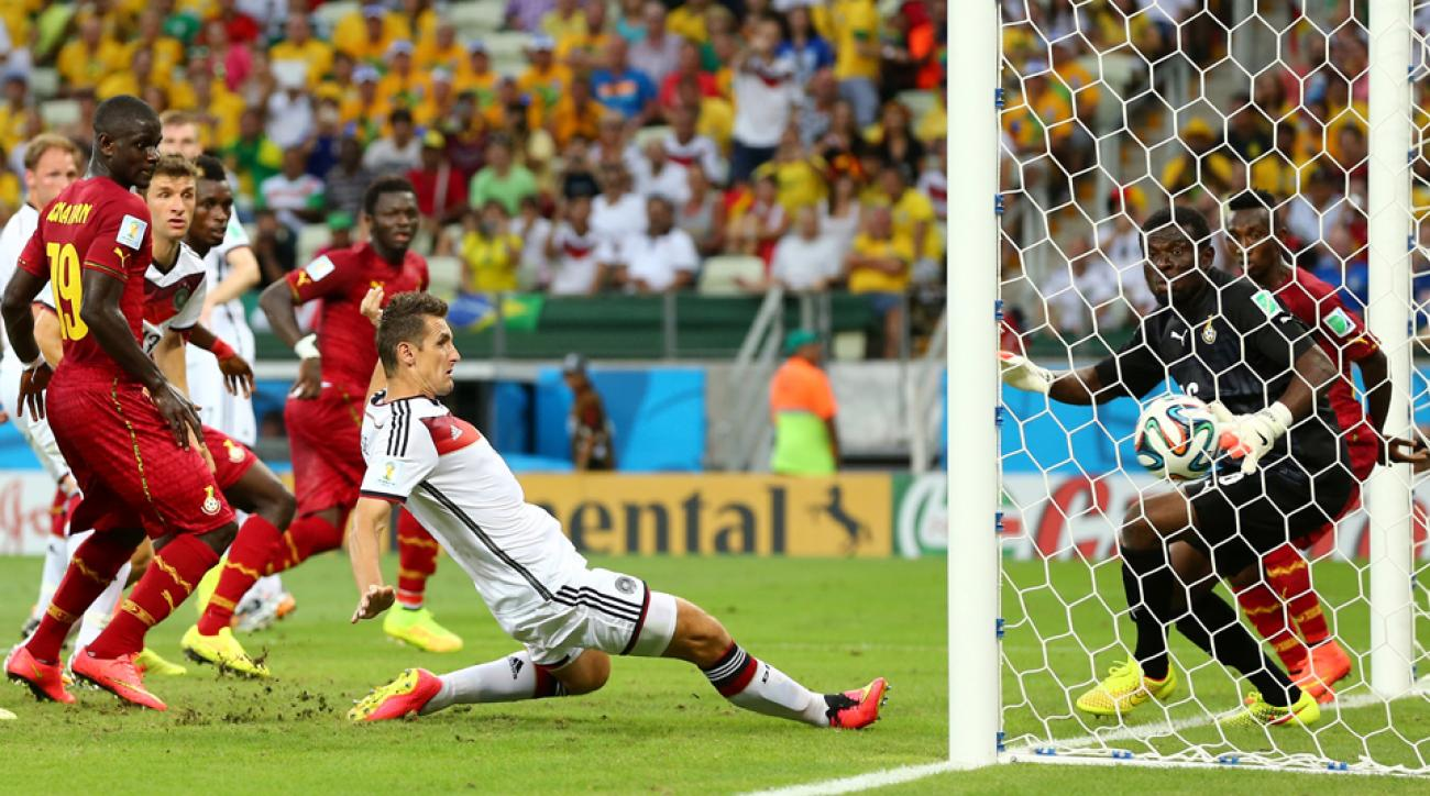 Miroslav Klose extends his leg to score the 15th World Cup goal of his career, tying the record held by former Brazil star Ronaldo.