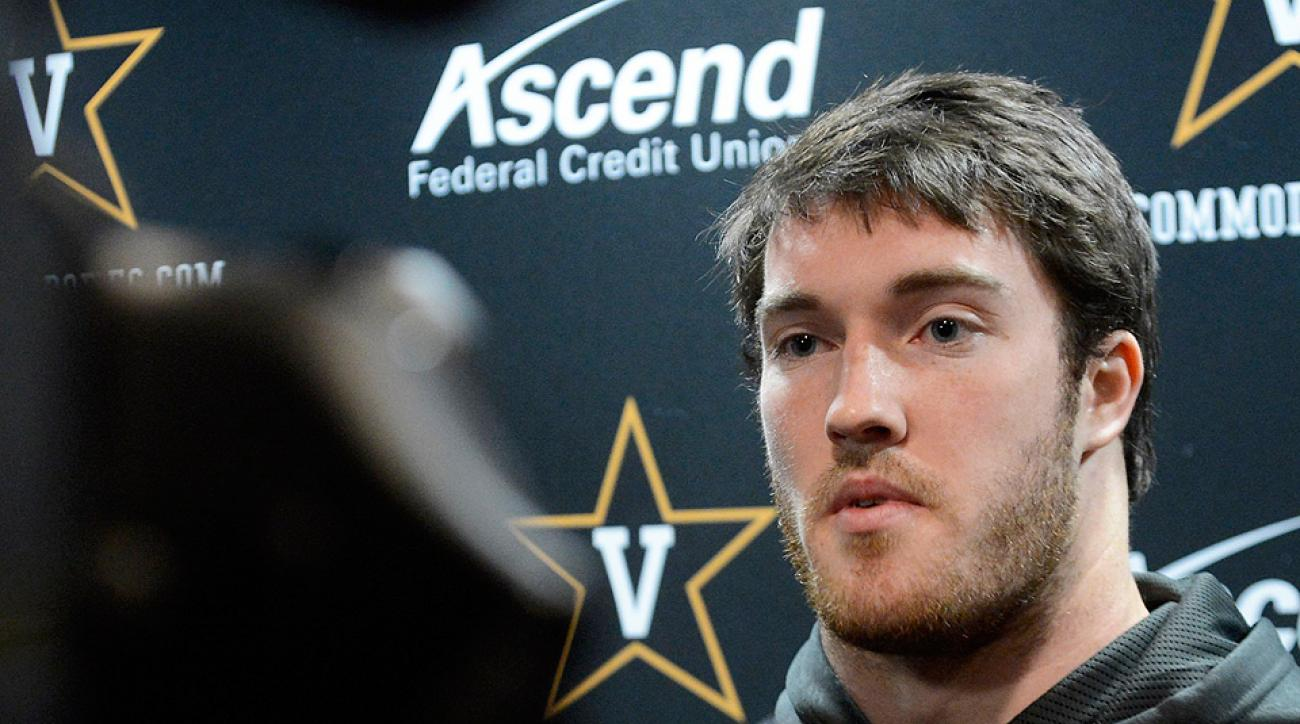 Are amateur athletes, like Chase Garnham of Vanderbilt (above), unwillingly endorsing products in press conferences and on sidelines without receiving compensation?