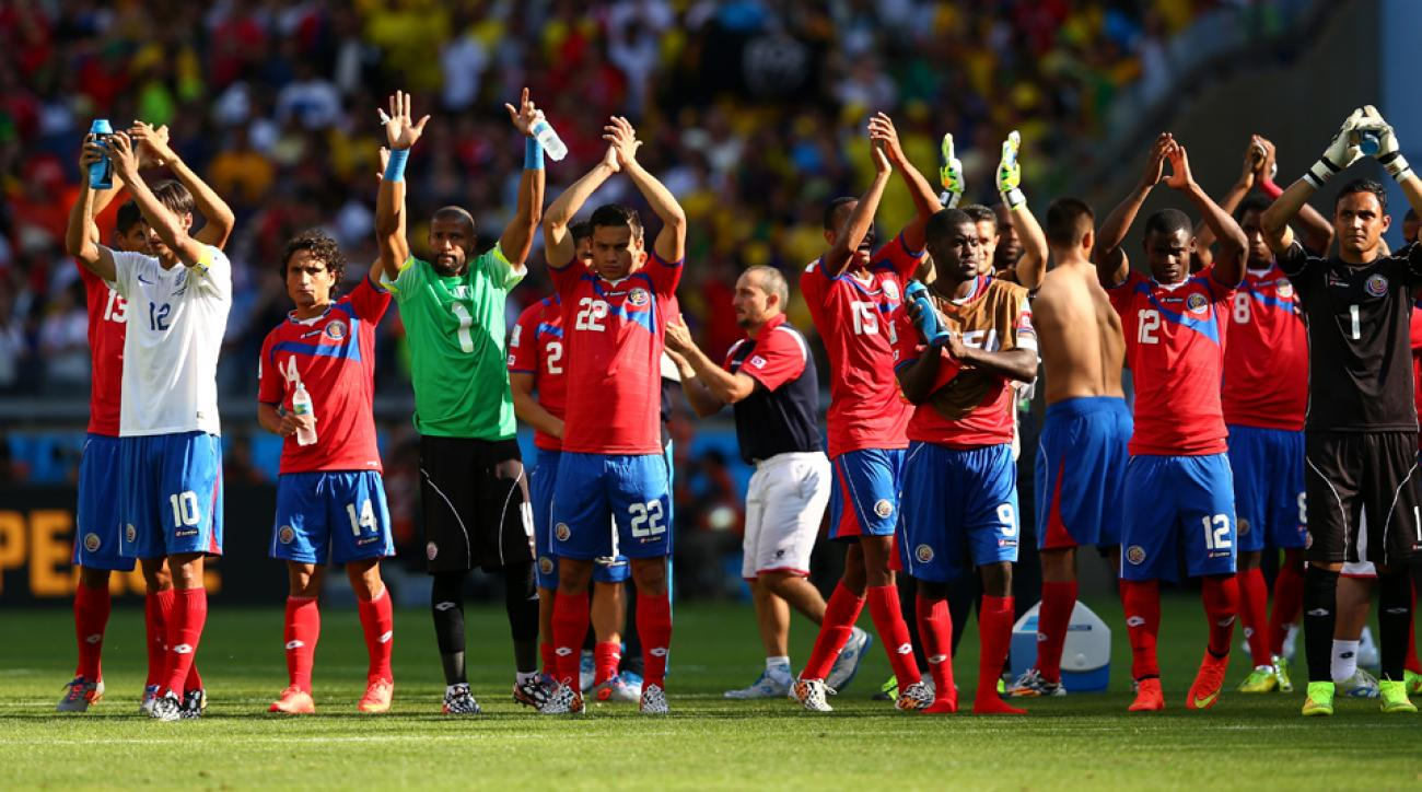 Costa Rica players salute their fans after securing first place in Group D with a 0-0 draw against England on Tuesday.